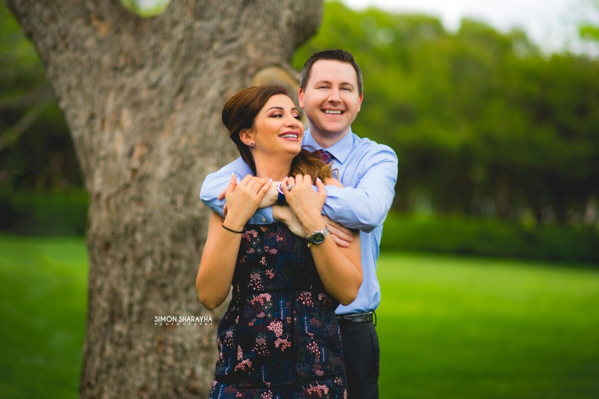happy couples posing for engagement photography