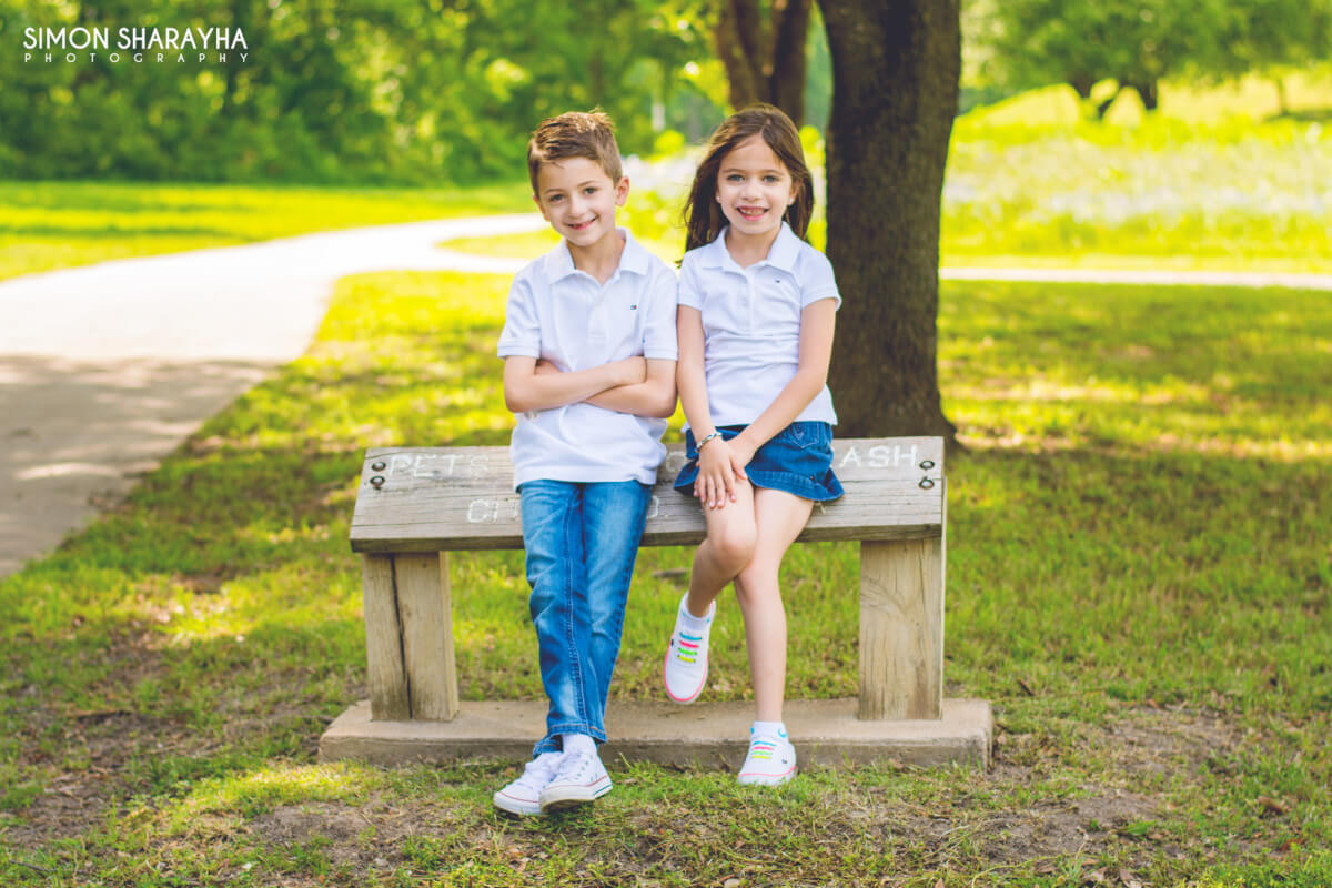 two cute kids posing for camera